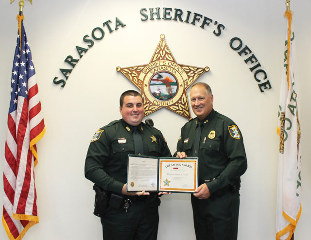 Deputy Adam Maio (left) accepts his award from Sheriff Tom Knight. Contributed photo