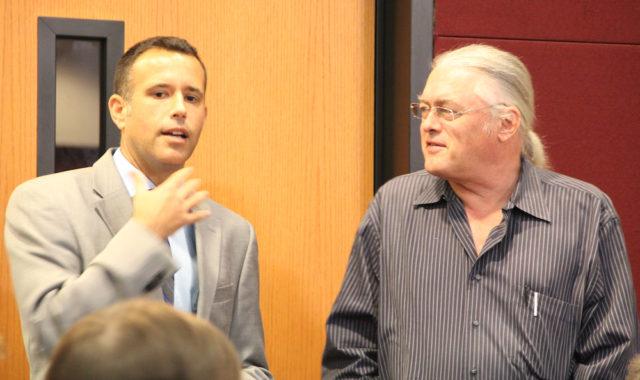 Matt Osterhoudt (left) speaks with Jono Miller before the hearing begins on Oct. 25. Rachel Hackney photo