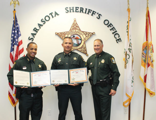 Sheriff Tom Knight recognizes Deputies Perozo (left) and Martin. Contributed photo
