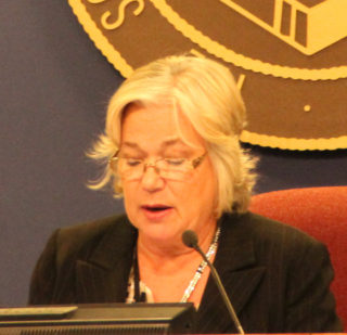Chair Shirley Brown reads the guidelines for the naming of the new superintendent during the Oct. 18 board meeting. Rachel Hackney photo