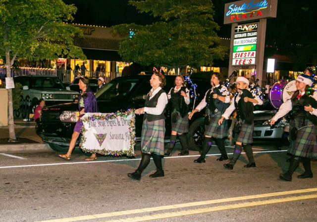 The Blue Skye Pipes and Drums group marches down Ocean Boulevard. Photo contributed by Peter van Roekens