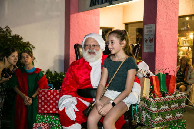 Santa poses with another visitor eager to share her wish list with him. Photo contributed by Peter van Roekens