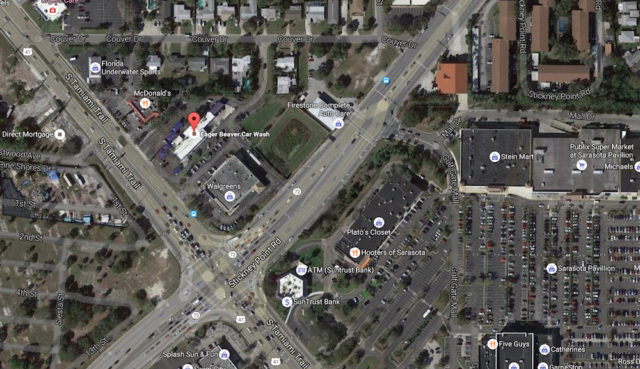 An aerial map shows the location of the Eager Beaver Car Wash (marked with the balloon) to the left of the project site. Image from Google Maps