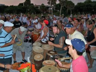 A variety of people participate in the Drum Circle each Sunday evening on Siesta Key Beach. Image from TripAdvisor