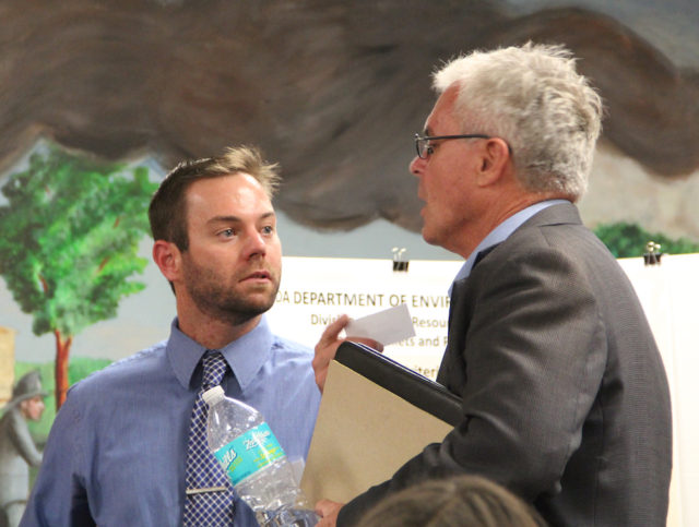 FDEP Project Manager Greg Garis (left) talks with Danny Bilyeu, field representative for U.S. Rep. Vern Buchanan, a Longboat Key Republican. Rachel Hackney photo