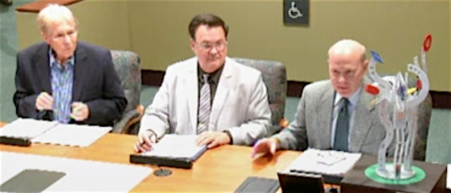 (From left) Jeffrey Weisman, Clifford Smith and David Smith address the City Commission. News Leader photo